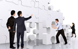 SYSTEMIZEbusiness teamwork - business men making a puzzle over a white background